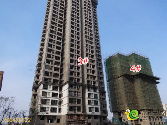 除了4#楼没有封顶,其他的八栋楼都已封顶,现在正在做外立面的建设工图片