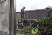 忆通壹世界项目:工人正在装饰外墙